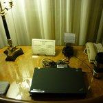 Desk with desktop power outlet and Ethernet jack