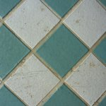 Scuffed, dirty tile floor in room 1145
