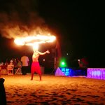 Fire dancers at the beach party
