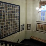 Stairwell with antique quilt and other historical infomratio