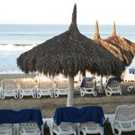 Beach palapas and lounge chairs