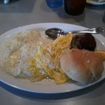 Grits, scrambled eggs, turkey sausage patties & biscuit