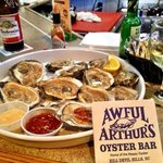 the freshest raw oysters shucked by the bartender.
