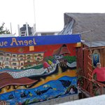 Blue Angel Mural with the restaurant on the right.