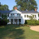 Built in 1847, this Greek Revival home sits on 7 peaceful acres of arboretum grounds