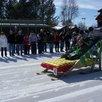 Winter Carnival bed sled races in front of EG's