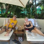 Pam & Mike on loungers by pool at Beach/Ocean Club