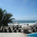 Ocean/Beach club cabanas and loungers by infinity pool or on beach
