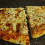 Pizza with onions at the Italian Job restaurant in Port Antonio, Jamaica.