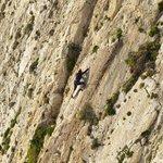 Pascale slab-surfing on 'Breezy Rib', Xaqqa Valley, Malta