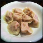 Boiled dumplings stuffed with minced pork served Beijing-style with a vinegar