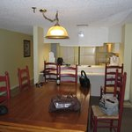 Dining table and kitchen area.