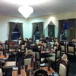 The upstairs function room, with beautiful hand made furniture to dine on at Jannat Restaurant