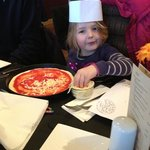 my daughter making her own pizza
