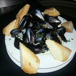 A heaping bowl of mussels, also came with a side of fries.