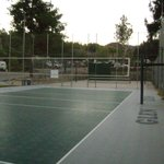 Outdoor vollyball, basketball, & handball court (next to horseshoe pit)