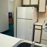 Each Suite Features Kitchen with Full Size Refrigerator, Stove and Microwave