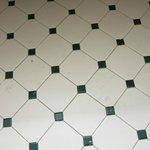 paint on tile floor in bathroom