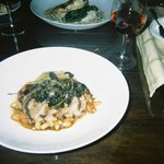 Pork with bean ragout and braised kale.