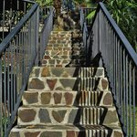 Beautiful stairways connecting the cottages, dining room, pool and tiki bar.l