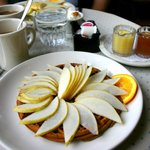 Gingerbread waffle with fresh pears and hot syrups