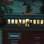 Moonlit train passing the Diner