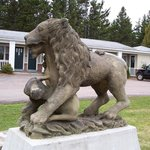 100+ year old carved lion on front lawn