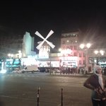View of the Moulin Rouge at the end of the road