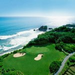 Arial view overlooking Tanah Lot temple and golf course 7th green