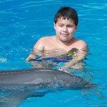 un viaje a un zoologico donde se podia nadar con delfines (no vayan son solo p