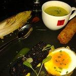 black pudding soft egg, fish finger, pea veloute