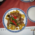 One of the dishes in a course menu, beef with vegetable
