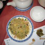 One of the dishes in a course menu, fried rice