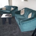 longe sofa and chair, comfortable but date