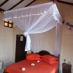 Frangipani festooned bed for our arrival