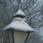Lamp post after snowfall.