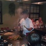 one of the hibachi chefs putting on a show.