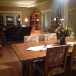 Dining room overlooking one of the living rooms w fireplace.