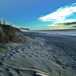 The beach is just a short walk away across the dunes