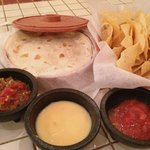 Ted's is well-known for their set-ups. Pictured are atomic salsa (left), queso