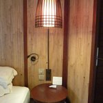 Metal cage/shade over lamp; table is so small it's easy to bang one's head - e