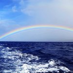 Rainbow over the ocean while on a fishing excursion