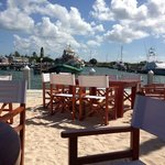 Dock side tables, comfy chairs in beach sand
