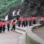 A group of  small school kids entering the Cave Temple