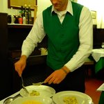 Valerio the waiter plating our entres to share