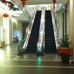 Up the escalator and hope you'll meet a hotel staff -1