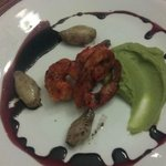 Grilled Yucatecan Shrimp served with avocado puree, glazed spring onions and r