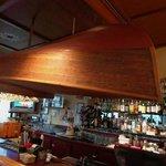 Unique upside-down boat glassholder above bar