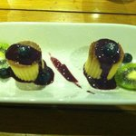 Goat cheese flan with blueberry puree