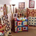 Some of their quilts on display